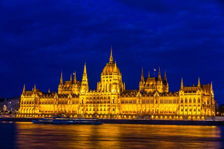 Night light on the flood lit Hungarian Parliament Building, landscape, at angle, wide angle.