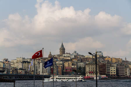 Istanbul, Turkey,  The Golden Horn with ferry boats and Galata Tower , on October 30 2019 in Turkey Редакционное