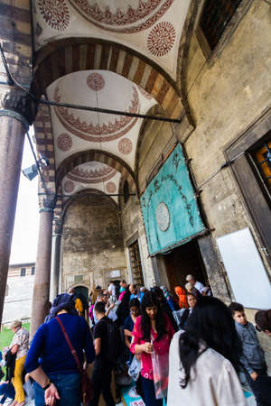 Istanbul, Turkey,  Tourists at the entrance of the Blue Mosque, landscape, on October 30 2019 in Turkey