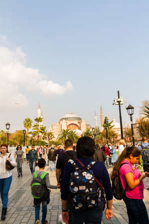 Istanbul, Turkey,  Tourists walking towards the Hagia Sophia Grand Mosque, portrait copyspace at top, on October 30 2019 in Turkey