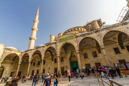 Istanbul, Turkey,  Tourists in the forecourt and entrance of the Blue Mosque, on October 30 2019 in Turkey