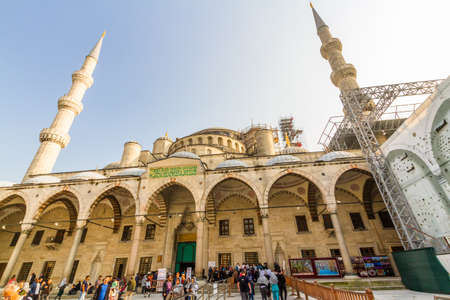 Istanbul, Turkey,  Tourists in the forecourt and entrance of the Blue Mosque, landscape, on October 30 2019 in Turkey