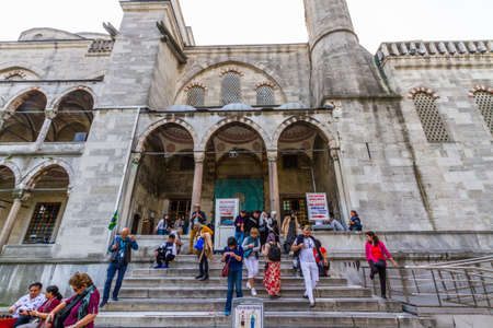 Istanbul, Turkey,  Tourists at the exit of the Blue Mosque, landscape, on October 30 2019 in Turkey Редакционное