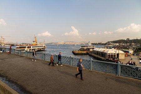 Istanbul, Turkey,  Galata Bridge over the Golden Horn, on October 30 2019 in Turkey Редакционное