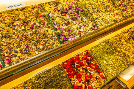 Trays of dried herbal tea leaves and fruits in market, Istanbul, Turkey. Фото со стока