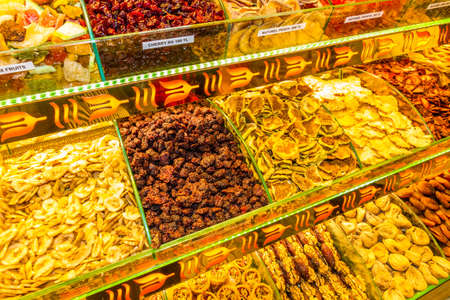 Trays of dried fruit and sweets in market, Istanbul, Turkey, landscape.
