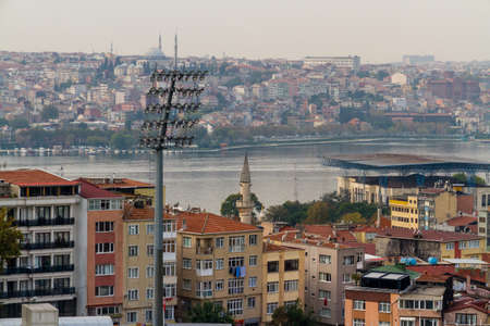 Istanbul, Turkey, with the Golden Horn Bosphorus river and Stadium Floodlight in foreground. Фото со стока