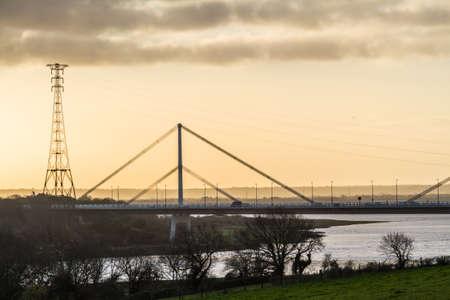 Wye Bridge carrying the M48 in morning light with pylon, landscape blur blurred. Фото со стока