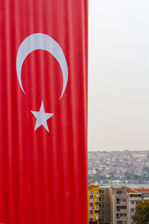Vertical Turkish Flag with city of Istanbul in background, Portrait. Фото со стока