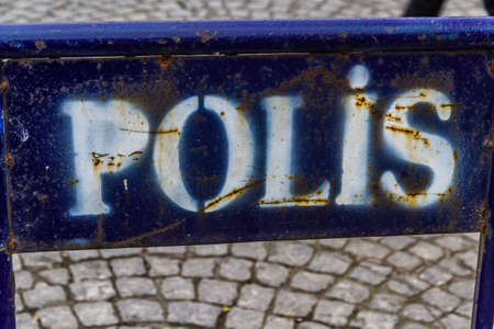 White on blue metal sign for Polis Police, Istanbul, Turkey.