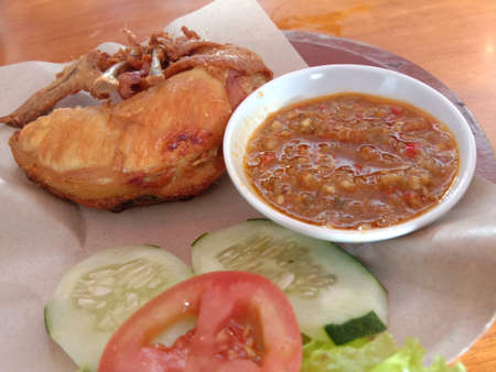Famous traditional Indonesian food. Delicious ayam goreng with sambal belacan, Fried chicken