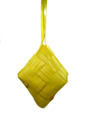 Ketupat or rice dumpling is a local delicacy during the festive season. Ketupats, a natural rice casing made from young coconut leaves for cooking rice on a white background 스톡 콘텐츠