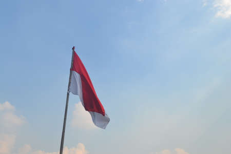 Indonesian Flag, Red and White, with blue sky background, hero day (Hari Pahlawan)