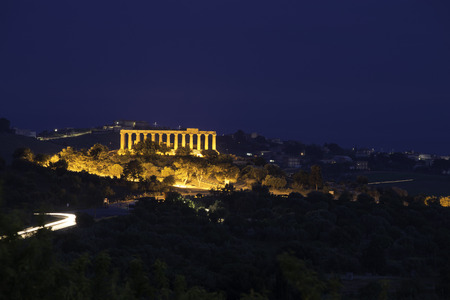 A light trail at Temple Valley, Agrigento, shot at blue hour. The Concordia Temple is showing all is magic on the background.