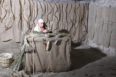 ISPICA (RG) - ITALY/SICILY 1 1 2018: The living nativity scene of Ispica is said to be the most beautiful in Sicily, here arrived at the 20th edition. In the picture, worker of wicker. Editoriali