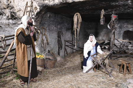 ISPICA (RG) - ITALY/SICILY 1 1 2018: The living nativity scene of Ispica is said to be the most beautiful in Sicily, here arrived at the 20th edition. In the picture, Joseph, Mary, Jesus