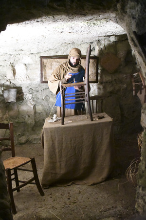 ISPICA (RG) - ITALY/SICILY 1 1 2018: The living nativity scene of Ispica is said to be the most beautiful in Sicily, here arrived at the 20th edition. In the picture, worker of wickers.