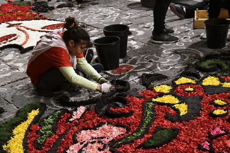 NOTO, ITALY - MAY 19th 2018: The famous Infiorata, in Noto, the town in Sicily famous for its baroque. Artists associations are creating drawings with flowers and petals in the gorgeous Via Nicolaci.