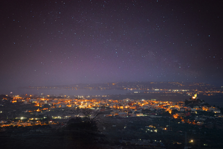 Siracusa , Italy, seen from above, with the Milky way