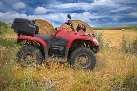 A nice red quad in the country. Zdjęcie Seryjne