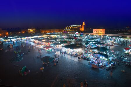Marrakech, Morocco - May 11 2019: Jema Eel-fna Square seen at night, full of life and activities, tourists, merchants, restaurants, stalls.