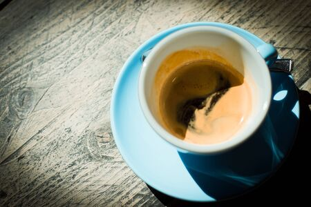 Espresso Coffe in a Turquoise Cup on a Wooden Table.