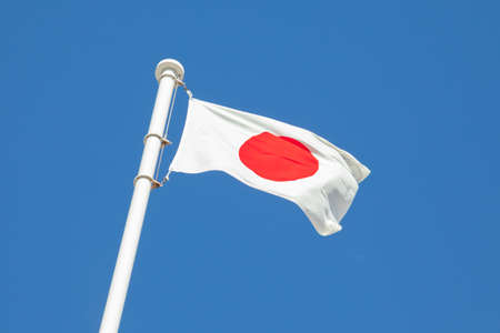 Japan flag in the blue sky 写真素材