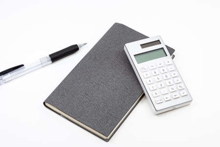 Notebook and calculator and ballpoint pen