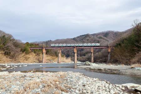 a train passing on Arakawa Bridge 版權商用圖片