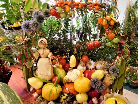 Beautiful basket of vegetables. There is dolly too. Stock Photo