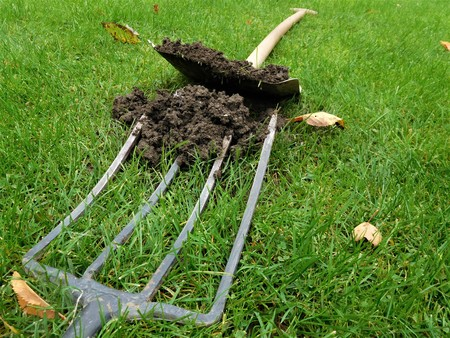 The pitch fork is tool for clay and dung. Who lives in countryside know what is it. With grass can be useful image.
