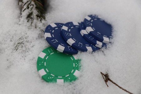 Some hazard player throw to snow a few jettons from casino Stok Fotoğraf