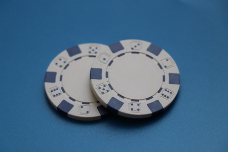 A two white and blue jettons for gambling and play some hazard Stok Fotoğraf