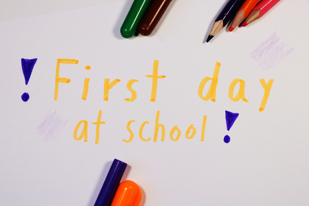 A inscription with exclamation marks on sides. Also there is many pencils and felt tip pens. Elementary school