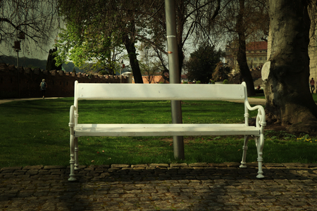 A beautiful white bench with white plank in the prague park. Czech republic Redactioneel