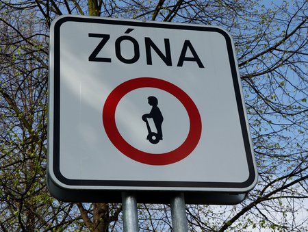 A traffic sign with small men