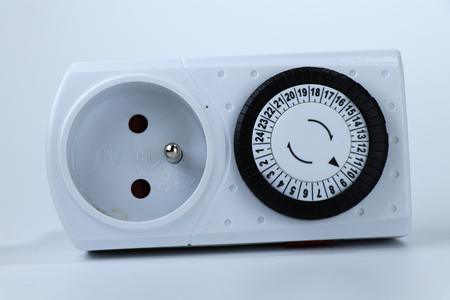 A switching socket with timer for saving energy and for precise setting system. White background Reklamní fotografie