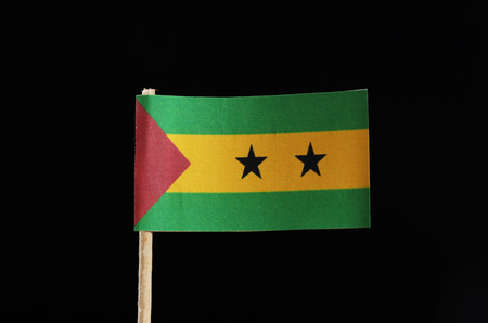 A official flag of Sao Tomé and Príncipe on toothpick on black background. Sao Tomé and Príncipe is located in central africa on island Standard-Bild