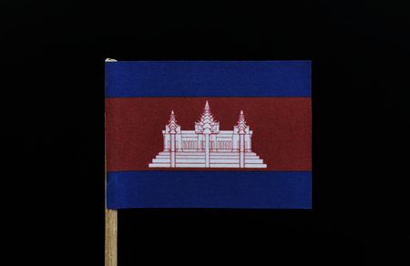A original and unique flag of Cambodia on toothpick on black background. Three horizontal bands of blue, red  and blue, with a depiction of Angkor Wat in white centred on the red band
