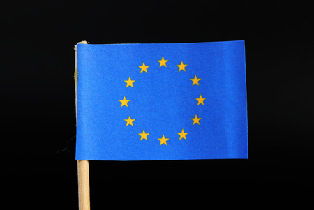 A unique and official flag of Europe on toothpick on black background. A circle of twelve five-pointed yellow stars on a blue field. Stockfoto