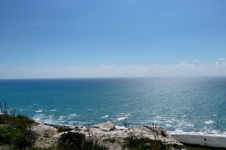 View on Kourion beach from rock. Beautiful small rock with incredible view on sea. Scenery, Panorama. Super aerial view of Blue Lagoon in Cyprus. Impressive rocky beach. Фото со стока