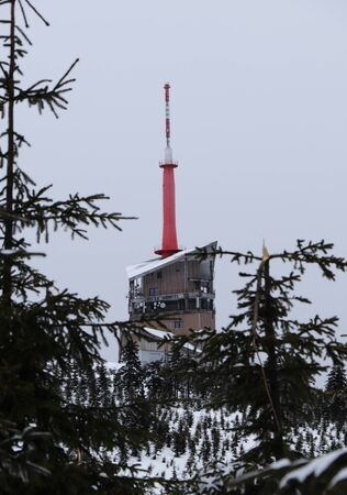 The highest place in Beskydy Mountains, czech republic center of Europe. Lysa hora is a symbol of Moravian lands. Building contains TV transmitter and Weather station. Bad weather. Fog and snow. Stok Fotoğraf