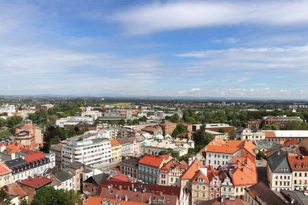 Wonderful view from historical tower in Hradec Kralove. Market square and historical part of town. Ancient houses alternating with trees. Ecological city in czech republic.