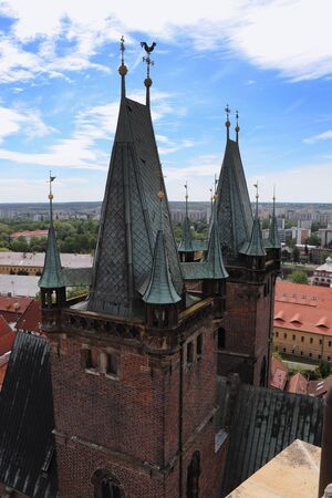 Cathedral of the Holy Spirit towers in Hradec Kralove, czech republic with blue sky and white clouds. Principal church. Basilica with two towers, which is located in the corner of Great Square. Stok Fotoğraf
