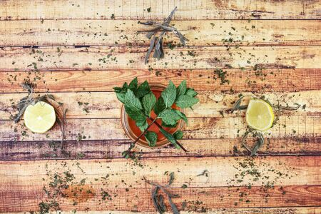 Typical natural sweetener to hot drinks with high content vitamine C and others. Lemons and mint leaves is next opportunity for earns some vitamines. Modern apothecary. Concept of cold and healthy.