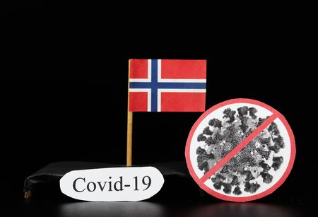 National flag of Norway with cell of covid-19 and word coronavirus. Fast spreading disease worldwide. Covid-2019 is a stronger flu which affects seniors and sick people. Dangerous and agressive.
