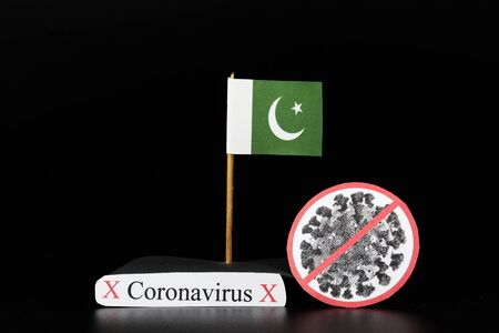 National flag of Pakistan union with cell of covid-19 and word coronavirus. Fast spreading disease worldwide. Covid-2019 is stronger flu which affects seniors and sick people. Dangerous and agressive.