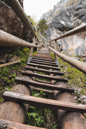 Old but solid wooden ladder in a beautiful gorge in the southeast of Austria in Styria. Bear gorge. Barenschutzklamm. Route to the treasure. Trail along beautiful waterfalls in the Fischbach Alps.