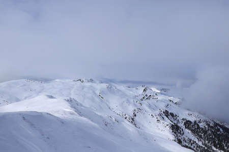 Snowy plains in the west of Austria in Tyrol, not far from the Italian border. View from the highest cable car station in Sillian ski resort on Hochrast peak, Gumriaul mountain.