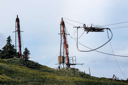 Final stop on the lift. Forgotten ski resort in Hruby Jesenik. Rusty pole with rope at anchor and driving people to the top of the mountain. Nature reserve. Lift abandoned. Czech republic.